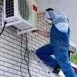 Stock Photo: Air conditioning worker