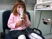 Girl on the inhalation — Stock Photo