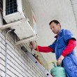 Stock Photo: Air conditioner worker