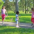 Children with skipping rope — Stock Photo #24836047