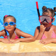 Girls in the swimming pool — Stock Photo