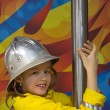 Girl in the fireman uniform — Stock Photo