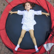 Girl on the trampoline — Stock Photo