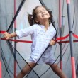 Girl in the trampoline — Stock Photo