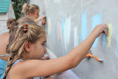 Girl drawing wall with chalk — Stock Photo