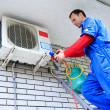 Air conditioner worker — Stock Photo #29275597