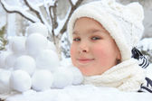 Girl with snowballs — Stock Photo