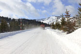 Cleaning snow from the road — Stockfoto