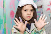 Girl with paint on the hands — Stock Photo