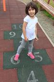 Girl on the hopscotch — Stock Photo