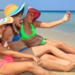 Girls making self portriat on the beach — Stock Photo #51778117