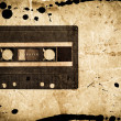 Grungy audio cassette - Stock Photo