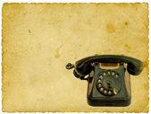 Old black phone on vintage background — Stock Photo