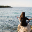 Stock Photo: Meditation by the sea