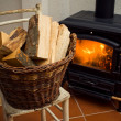 Basket full of logs - Foto Stock
