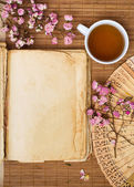 Old blank book with green tea — Stock Photo
