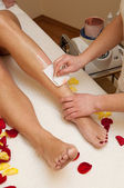 Depilation with wax in beauty salon — Stock Photo