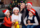 Happy family celebrating Christmas — Стоковое фото