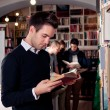 Stock Photo: Reading book in library