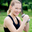 Workout with dumbbells — Stock Photo