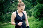 Jogging and enjoying music — Stock Photo