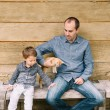 Father, son and a cat — Stock Photo
