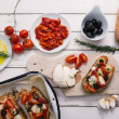 Preparing Italian bruschetta — Stock Photo #39874473