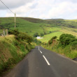 Empty road in northern Ireland - Stock Photo