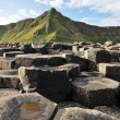 Giant's Causeway stones and mountain — Stock Photo