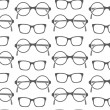 Set of fashionable glasses silhouettes seamless background - Stock Vector
