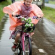 Royalty-Free Stock Photo: Girl cycling in the rain