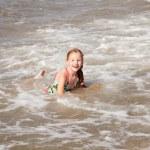 Girl having fun in the sea — Stock Photo
