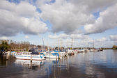 Dutch harbour with boats and clouds — Stock Photo