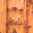 Stock Photo: Steps of old orange and rusty container on vertical image