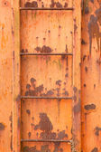 Steps of old orange and rusty container on vertical image — Stock Photo