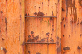 Steps of old orange and rusty container — Stock Photo