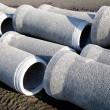 Grey concrete pipes waiting - Stock Photo