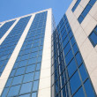 Stock Photo: Part of office building and blue sky