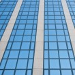 Blue sky reflected in grid of windows — Stock Photo