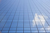 Sky reflected in facade of Delftse Poort in Rotterdam — Stock Photo