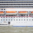 Stock Photo: Small boat and large cruise ship