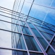 Facade of modern glass blue office and sky — Stock Photo