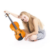 Young girl in dress happy with violin — Stock Photo