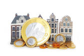 Miniature houses and euro coins — Stock Photo