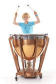 Young blond boy playing kettle drum — Stock Photo