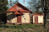Two little buildings at russian country railroad station — Stock Photo