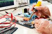 Computer board soldering — Stock Photo