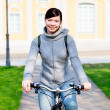 Girl on a bike - Stock Photo