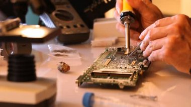 Repair of electronic equipment, solder a new element — Stock Video