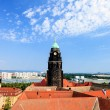 Stock Photo: Bell tower over the tiled roofs